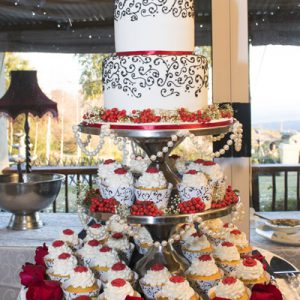 A traditional wedding cake with cupcakes for fun