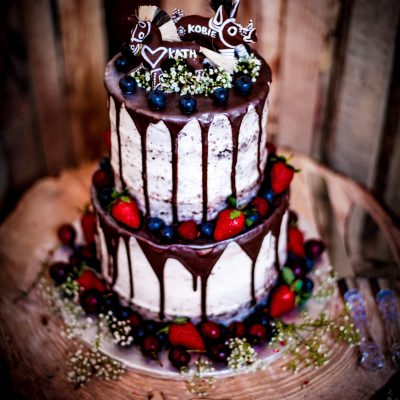 Decadent Black Forest cake with fresh fruit and traditional Hogsback cake toppers